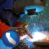 california an industrial welder wearing a welding helmet and safety gloves