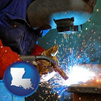 louisiana an industrial welder wearing a welding helmet and safety gloves