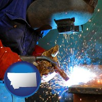 montana an industrial welder wearing a welding helmet and safety gloves