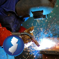 new-jersey an industrial welder wearing a welding helmet and safety gloves