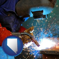 nevada an industrial welder wearing a welding helmet and safety gloves