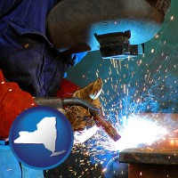new-york an industrial welder wearing a welding helmet and safety gloves