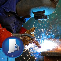 rhode-island an industrial welder wearing a welding helmet and safety gloves