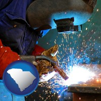south-carolina an industrial welder wearing a welding helmet and safety gloves