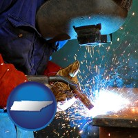 tennessee an industrial welder wearing a welding helmet and safety gloves