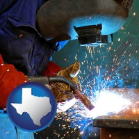 texas an industrial welder wearing a welding helmet and safety gloves