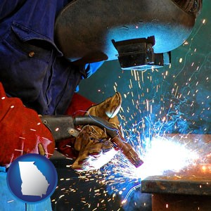 an industrial welder wearing a welding helmet and safety gloves - with Georgia icon