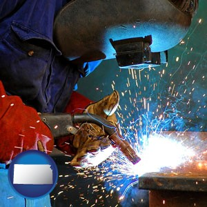 an industrial welder wearing a welding helmet and safety gloves - with Kansas icon