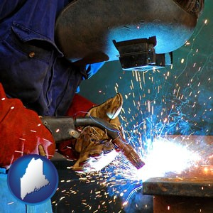 an industrial welder wearing a welding helmet and safety gloves - with Maine icon